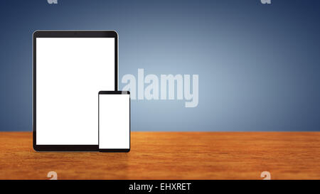 Large tablet and smartphone with blank screens on wooden counter top with blue background , copyspace - Stock Photo