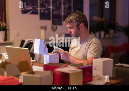 Man installing wireless sockets - Stock Photo