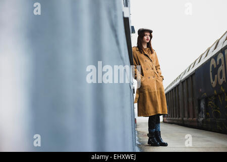 Young woman standing on platform - Stock Photo