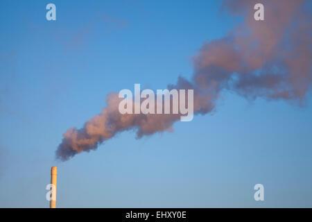 Germany, smoking chimney - Stock Photo