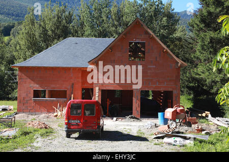 A house under construction in Argein, a village in the rural Midi Pyrenees in south western France - Stock Photo