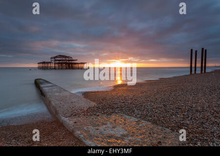 Sunset at West Pier ruins in Brighton, East Sussex, England. - Stock Photo