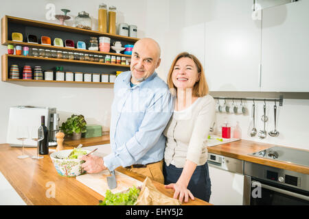 Senior couple in kitchen, portrait - Stock Photo