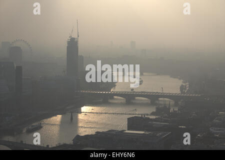 LONDON, UK -18th March 2017: A view of the River Thames on a foggy/misty day. - Stock Photo