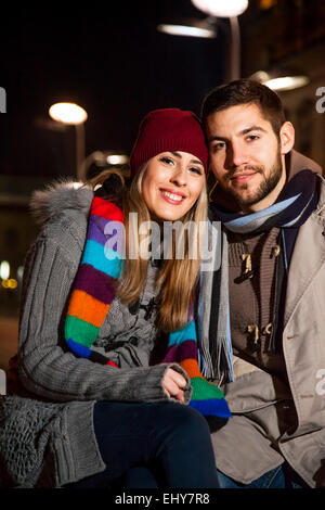 Portrait of happy young couple in city - Stock Photo