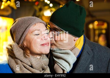 Senior couple at Christmas market, Bad Toelz, Bavaria, Germany - Stock Photo