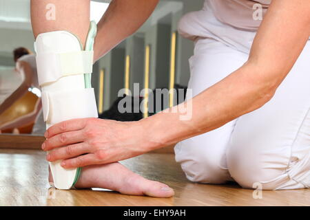 A Orthopedist  with Patient and Ankle orthosis - Stock Photo