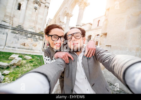 Couple taking selfie picture - Stock Photo