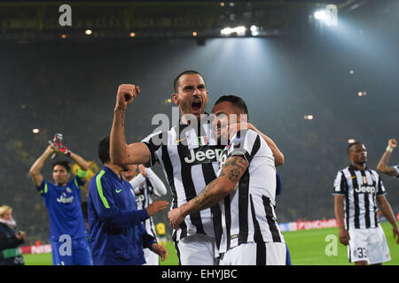 Dortmund, Germany. 18th Mar, 2015. Turin's Leonardo Bonucci (l) and Simone Pepe celebrate during the Champions League - Stock Photo