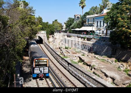 A Tram running through Monastiraki in Athens, Greece. - Stock Photo