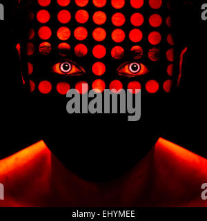 Man's face with red dots - Stock Photo