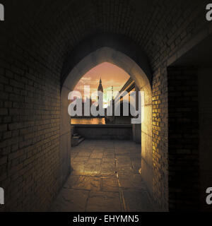 View of Big Ben through an arch across the River Thames, London, UK - Stock Photo