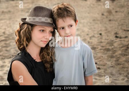 Portrait of a young woman and boy - Stock Photo