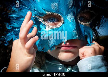 Girl wearing a carnival mask - Stock Photo
