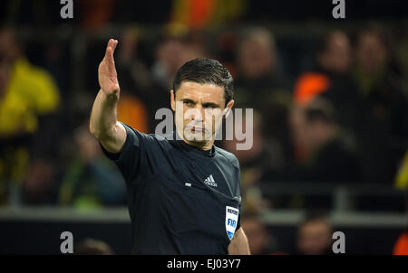 Dortmund, Germany. 18th Mar, 2015. Referee Milorad Mazic reacts during the Champions League Round of Sixteen soccer - Stock Photo