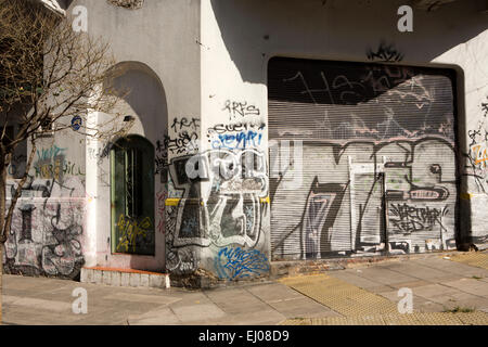 Argentina, Buenos Aires, Almagro, Pringles, house door and shutters covered in graffiti - Stock Photo