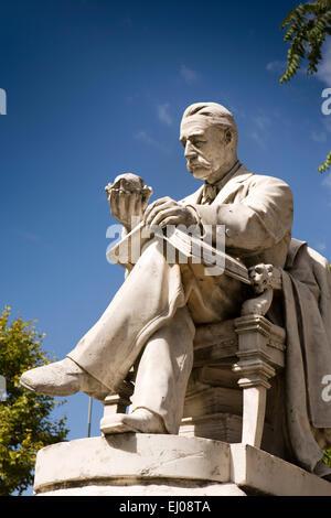 Argentina, Buenos Aires, Cabalito, Parque Centenario, Centenary Park, statue of man studying vegetable - Stock Photo