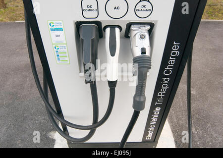 electric car cars recharging point charging charge plug plugging in socket sockets recharge up batteries electrical - Stock Photo
