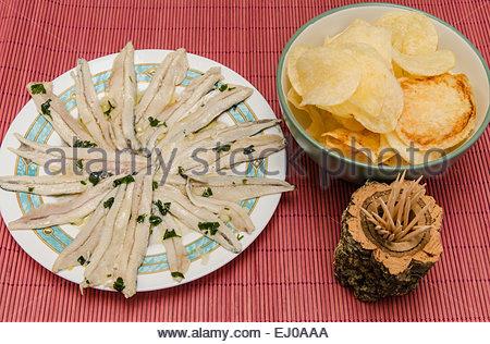 Raw anchovies with garlic, oil and vinegar. Boquerones en vinagre. - Stock Photo
