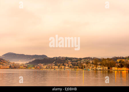 Lugano and lake Lugano with mountain and colorful sky in dusk in Ticino, Switzerland, Europe, . - Stock Photo
