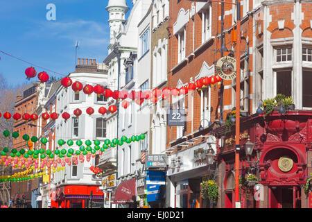 London, Soho    Wardour Street decorated with Chinese lanterns celebrating the Chinese New Year - Stock Photo