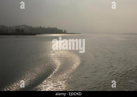 Lagoon of Stettin, water, waves, gleam of light, Wolgast, Mecklenburg-Vorpommern, Germany - Stock Photo