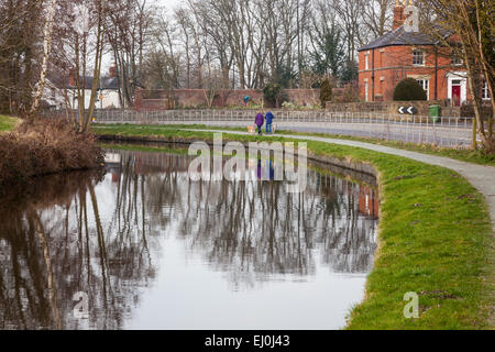 Dog walkers on the towpath of the Llangollen Canal near Chirk Bank, England - Stock Photo