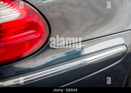 Close up detail of the rear end of a automobile. - Stock Photo