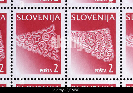 Slovenian postage stams showing Idrijan Lace - traditional craft in Idria, Slovenia. In se-tenant pairs - Stock Photo