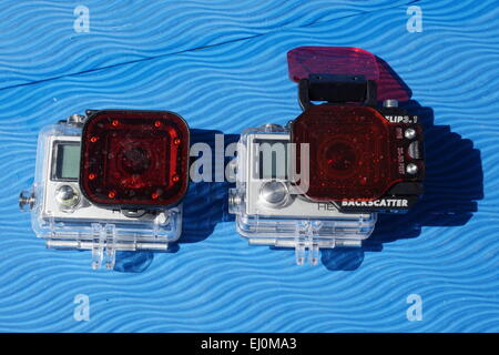 Go PRO Cameras with red color correction filter for diving. - Stock Photo