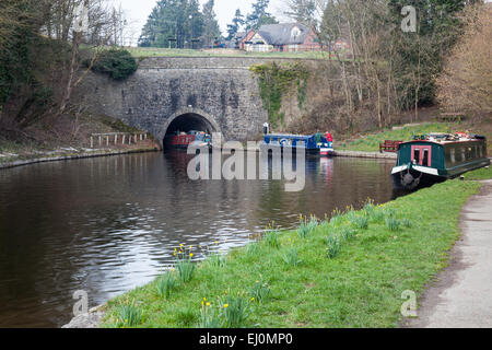 A narrow boat emerges from the Chirk tunnel on the Llangollen Canal, near the Chirk aqueduct, Chirk, Wrexham, Wales - Stock Photo