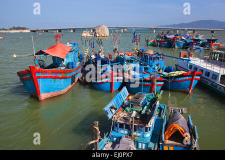 Nha Trang, Khanh Hoa province, Vietnam, SE Asia, South East Asia, blue, red, traditional, fishing boats, bridge, - Stock Photo