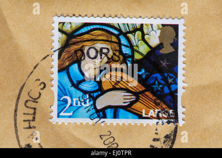 2nd class Christmas stamp on envelope - Stock Photo