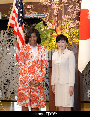 Tokyo, Japan. 19th Mar, 2015. US First Lady MICHELLE OBAMA is welcomed by Japan's First Lady AKIE ABE upon her arrival - Stock Photo