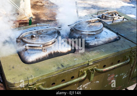 Mobile metal kitchen stove to feed soldiers - Stock Photo