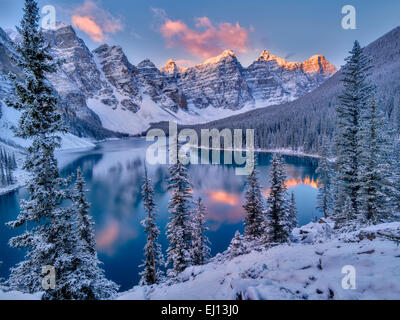 Sunrise and first snow of the season on Moraine Lake. Banff National Park, Alberta, Canada - Stock Photo