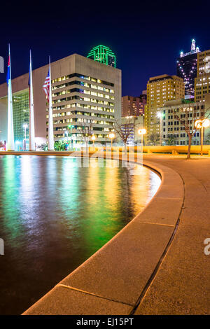 The reflecting pool at City Hall and buildings at night, in Dallas, Texas. - Stock Photo