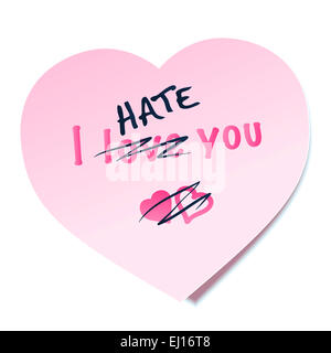 I HATE YOU written on a heart shaped pink sticky note, the word LOVE is crossed out - as a symbol for lovesickness. - Stock Photo