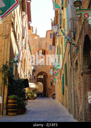 Narrow medieval street in Siena, Italy - Stock Photo