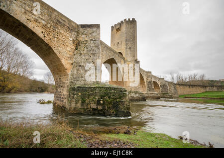 Scenic view of an ancient stone medieval bridge on a cloudy day in Frias, Castilla y Leon, Spain. - Stock Photo