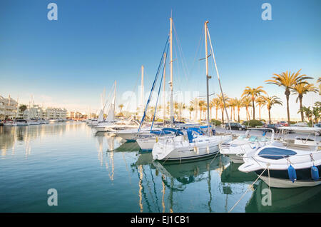 BENALMADENA, SPAIN - APRIL 29: Scenic view of some Yachts in Marina port at dusk, in Benalmadena, Malaga, Spain - Stock Photo