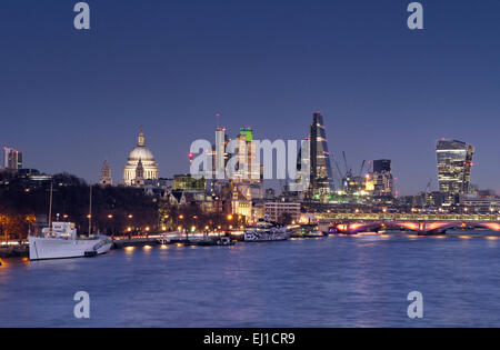 LONDON CITY FINANCE SKYLINE NIGHT DUSK THAMES City of London cityscape lights & River Thames from Waterloo Bridge - Stock Photo