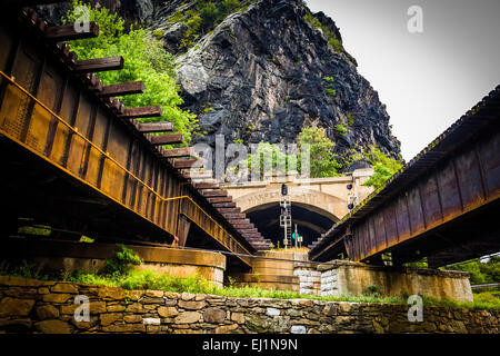 Train bridges and tunnel in Harper's Ferry, West Virginia. - Stock Photo