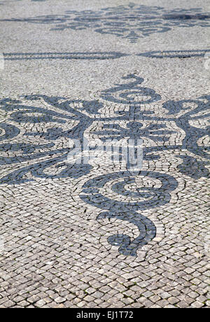 Patterned Cobbles on Central Aisle of Avenida da Liberdade in Lisbon - Portugal - Stock Photo