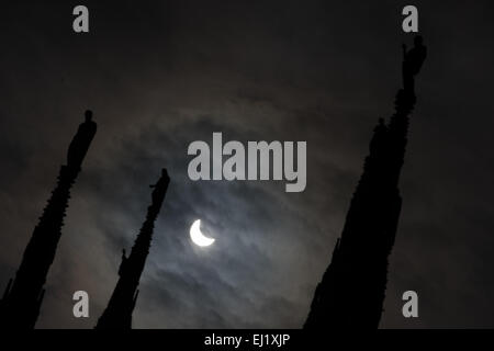 Milan, Italy - 20 March 2015: Partial solar eclipse seen through the steeples of Duomo di Milano Credit:  Piero - Stock Photo
