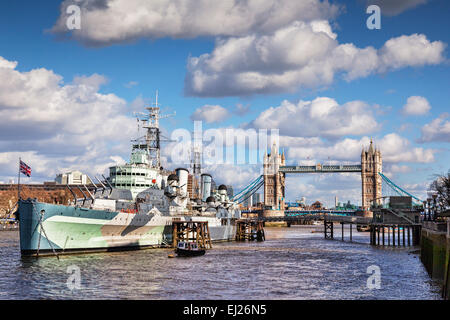 HMS Belfast on the River Thames, and Tower Bridge, London. - Stock Photo