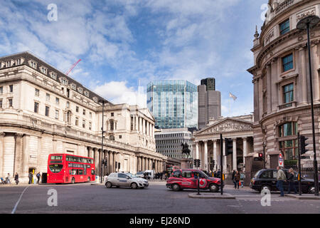 A street scene in Threadneedle Street, London, England, with the Bank of England on the left. The glass building - Stock Photo