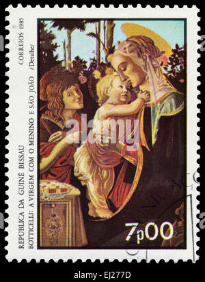 GUINEA BISSAU - CIRCA 1985: Stamp printed in Guinea-Bissau shows Madonna of the Rose Garden by Botticelli, circa - Stock Photo