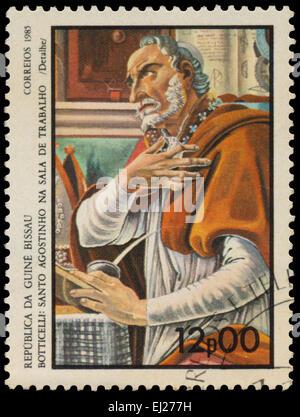 GUINEA BISSAU - CIRCA 1985: Stamp printed in Guinea-Bissau shows St. Augustine by Botticelli, circa 1985 - Stock Photo