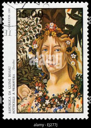 GUINEA BISSAU - CIRCA 1985: Stamp printed in Guinea-Bissau shows Spring by Botticelli, circa 1985 - Stock Photo